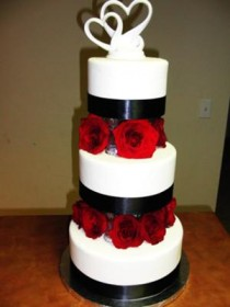 elegant-3tier-wedding-cake-with-black-ribbon-and-fresh-red-roses-21284872